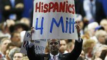 A participant shows support for Republican presidential nominee Mitt Romney during the final session of the Republican National Convention in Tampa, Florida, August 30, 2012. (Jason Reed/Reuters)