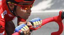 """Team Saxo Bank rider and leader of the race Alberto Contador of Spain cycles during the 21st stage of the Tour of Spain """"La Vuelta"""" cycling race between Cercedilla and Madrid, September 9, 2012. (MIGUEL VIDAL/REUTERS)"""