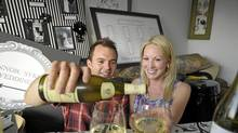 "Ben Sykes and fiance Erin Connor, sample wine for their wedding in their jammed ""wedding room"" in their Toronto condo, July 19, 2010. (J.P. Moczulski/The Globe and Mail/J.P. Moczulski/The Globe and Mail)"