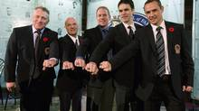 Hockey Hall of Fame inductees (left to right) Brett Hull, Lou Lamoriello, Brian Leetch, Luc Robitaille and Steve Yzerman show off their rings after being presented with them in a ceremony at the Hockey Hall of Fame in Toronto on Monday. (Frank Gunn/Frank Gunn/CP)