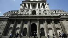 Pedestrians walk past the Bank of England in the City of London May 15, 2014. (Luke MacGregor/Reuters)