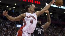 Toronto Raptors guard DeMar DeRozan (left) beats Brooklyn Nets forward Reggie Evans (right) to a rebound during first half NBA action in Toronto on Sunday April 14, 2013. (Frank Gunn/THE CANADIAN PRESS)