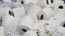 Discarded tissue sits in a bin at Cascades Tissue Group plant, in Candiac, Que., in a file photo. (Christinne Muschi For The Globe and Mail)
