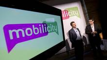 John Bitove, chairman of DAVE wireless, and then-president Dave Dobbin, present their new brand name and logo, Mobilicity, on Feb. 2, 2010 in Toronto. Editor's note: Mr. Bitove's name was misspelled and Mr. Dobbin's title was out of date in an earlier version of this caption. (Peter Power/The Globe and Mail)