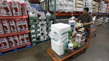A shopper loads his cart at a Costco Wholesale store in Arlington, Va., in this file photo. (RICHARD CLEMENT/REUTERS)
