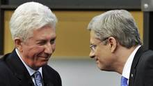 Bloc Quebecois Leader Gilles Duceppe, left, greets Conservative Party Leader and Prime Minister Stephen Harper after the French-language leaders' debate in the 2011 federal election. (POOL/Sean Kilpatrick/Reuters)