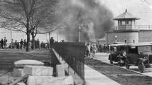 A fire which broke out on May 15, 1934, in the change room at Kingston Penitentiary and caused dense columns of smoke to spread across the city. (Credit Unknown)