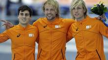 Athletes from the Netherlands, from left to right, Silver medallist Jan Smeekens, gold medallist Michel Mulder and bronze medallist Ronald Mulder pose for photographers during the flower ceremony for the men's 500-meter speedskating race at the Adler Arena Skating Center at the 2014 Winter Olympics, Monday, Feb. 10, 2014, in Sochi, Russia. (Matt Dunham/AP)
