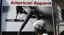 In this 2008 file photo people passing by near Yonge and Gould Streets, look up at an American Apparel store billboard in Toronto (Deborah Baic/Deborah Baic/The Globe and Mail)