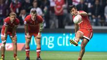 Canada's Nathan Hirayama, right, kicks a conversion to defeat France as teammates Harry Jones, left, and Adam Zaruba watch during World Rugby Sevens Series' Canada Sevens bowl final action, in Vancouver, B.C., on Sunday March 13, 2016. (DARRYL DYCK/THE CANADIAN PRESS)