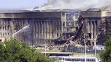 Smoke pours from the Southwest E-ring of the Pentagon building on Sept. 11, 2001, in Arlington, Va., after a hijacked plane crashed into the building. (Alex Wong/Getty Images/Alex Wong/Getty Images)