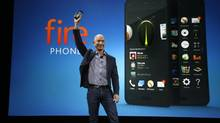 Amazon CEO Jeff Bezos holds up the new Amazon Fire Phone at a launch event, Wednesday, June 18, 2014, in Seattle. (Ted S. Warren/AP Photo)