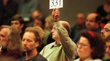 An unnamed bidder raises his paddle as he makes a bid on a painting during the Heffel fine art auction in Vancouver. (Jeff Vinnick/The Globe and Mail)