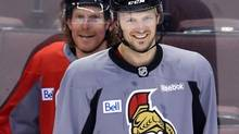 Ottawa Senators Jason Spezza shares a laugh with former teammate Daniel Alfredsson (FRED CHARTRAND/THE CANADIAN PRESS)