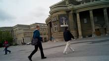 Students walk past Convocation Hall at the University of Toronto. (Sami Siva/Sami Siva/The Globe and Mail)