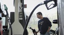 In this April 28, 2011 file photo, John Magel pumps gas at a station in Wethersfield, Conn. (Jessica Hill/AP2011)