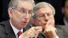 Philip Angelides, left, chairman of the Financial Crisis Inquiry Commission, and vice chairman Bill Thomas, listen to testimony Wednesday in New York. (Mark Lennihan/AP)