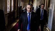 Hungarian Prime Minister Viktor Orban arrives for a Parliament session in Budapest, Hungary on Oct. 20. (AKOS STILLER/NYT)
