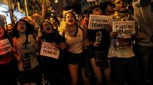 """Supporters of Brazil's suspended President Dilma Rousseff, shout slogans while holding signs that read """"Out Temer"""" in reference to interim President Michel Temer, during a protest in Sao Paulo, Brazil, August 30, 2016. (Nacho Doce/REUTERS)"""