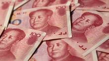 Yuan banknotes are seen in this illustrative photograph taken in Beijing in this file photo. (Petar Kujundzic/Reuters)