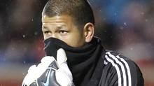 Goalie Nick Rimando #18 of Real Salt Lake tries to keep warm during a game against the Colorado Rapids during the second half of an MLS soccer game April 13, 2010 at Rio Tinto Stadium in Sandy, Utah. Real beat Colorado 1-0. (Photo by George Frey/Getty Images) (George Frey/Getty Images)