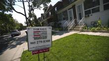 A for sale sign is seen on the lawn of a Toronto home in this file photo. (Galit Rodan/The Globe and Mail)