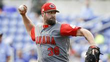 Team Canada pitcher Eric Gagne throws against the Toronto Blue Jays in the fourth inning of an exhibition baseball game, on March 7, 2017, in Dunedin, Fla. (John Raoux/AP)