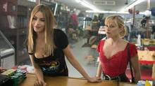 Sofia Vergara, left, stars as Daniella Riva and Reese Witherspoon as Officer Cooper in this comedy that's a chase film, a buddy film, ridiculous, loud and often offensive. (Sam Emerson/Warner Bros. Pictures)