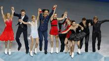 The Russian figure skating team steps onto the podium at the Sochi 2014 Winter Olympics on Feb. 9, 2014. (BRIAN SNYDER/REUTERS)