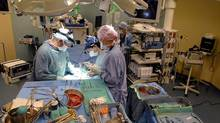 Surgeons at Toronto General prepare a patient to receive a kidney. (Deborah Baic/The Globe and Mail)