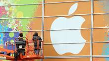 Workers apply the Apple logo to the exterior of the Yerba Buena Center for the Arts (Justin Sullivan/Getty Images)