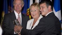 Conference co-chairs, Rhode Island Governor Lincoln D Chafee, left, and Quebec Premier Pauline Marois, centre, receive the Climate Group Award from CEO Mark Kenber at the opening of the 37th annual conference of the New England Governors and Eastern Premiers Monday, September 9, 2013 in La Malbaie, Que. (Jacques Boissinot/THE CANADIAN PRESS)