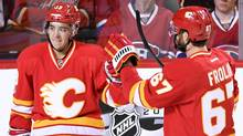 Flames left wing Johnny Gaudreau celebrates his third period goal with right wing Michael Frolik against the Montreal Canadiens at Scotiabank Saddledome. (Candice Ward/USA Today Sports)