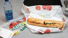 This photo taken Aug. 11, 2009, shows a chicken breast sandwich and water from Subway in New York. (Seth Wenig/The Associated Press)