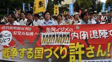 Protesters hold a banner to start their demonstration march against controversial security bills which would expand the remit of the country's armed forces, at a park in Tokyo on July 28, 2015. (TOSHIFUMI KITAMURA/AFP/Getty Images)