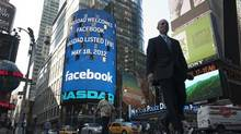 A monitor shows a welcoming message for Facebook's listing on the NASDAQ Marketsite prior to the opening bell in New York May 18, 2012. (KEITH BEDFORD/KEITH BEDFORD/REUTERS)