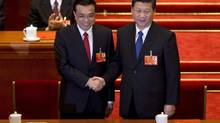 Newly-named Chinese Premier Li Keqiang, left, shakes hands with new Chinese President Xi Jinping during a plenary session of the National People's Congress held in Beijing's Great Hall of the People, March 15, 2013. (Alexander F. Yuan/AP)