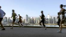 Runners can achieve a performance boost of between 2 and 6 per cent by tapering before a competition, research shows. (ANDY CLARK/REUTERS)