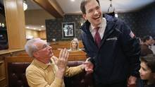 Republican presidential candidate Marco Rubio shares a laugh with a local resident at a restaurant in Manchester, N.H., on Feb. 8, 2016. After placing third in the Iowa caucuses, Rubio is hoping for a good showing when people in New Hampsire head to the polls in the 'First in the Nation' presidential primary. (Chip Somodevilla/Getty Images)