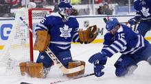 Toronto Maple Leafs goalie Jonathan Bernier catches the puck as defenceman Paul Ranger falls in front of the crease in the third period during the 2014 Winter Classic hockey game against the Detroit Red Wings at Michigan Stadium on Jan. 1. (Rick Osentoski/USA Today Sports)