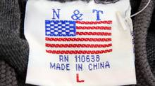The label of a sweatshirt for sale in Washington, D.C., bears a U.S. flag but says 'Made in China.' A recent survey, however, shows Americans are now more likely to buy goods made at home. (KEVIN LAMARQUE/REUTERS)