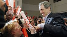 Liberal leader Michael Ignatieff (R) shakes hands during a campaign rally at Albert-Rousseau theater in Quebec City, April 28, 2011. Canadians will go to the polls in a federal election on May 2. REUTERS/Mathieu Belanger (Mathieu Belanger/Reuters/Mathieu Belanger/Reuters)