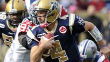 Winnipeg Blue Bombers quarterback Buck Pierce runs the ball against the Montreal Alouettes during first half CFL action in Winnipeg, October 22, 2011. REUTERS/Fred Greenslade (FRED GREENSLADE)