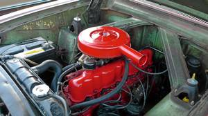 The way it used to be: The engine compartment of an early-1960's Ford Falcon shows how accessible and easy to understand cars used to be. In the 1960's and 1970's. do-it-yourself mehanics abounded.
