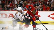 Jonathan Toews of the Chicago Blackhawks gets off a shot under pressure from Ryan Johansen of the Nashville Predators in Game Two of the Western Conference First Round during the 2017 NHL Stanley Cup Playoffs at the United Center on April 15, 2017 in Chicago, Illinois. The Predators defeated the Blackhawks 5-0. (Jonathan Daniel/Getty Images)