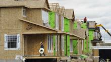 File photo of construction workers building new homes in Calgary. (TODD KOROL/REUTERS)