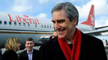 Liberal Leader Michael Ignatieff smiles as he arrives at the airport in St. John's on April 4, 2011. (Nathan Denette/THE CANADIAN PRESS)
