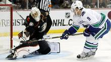 Anaheim Ducks goaltender Jonas Hiller (L) of Switzerland makes a save on a shot by Vancouver Canucks center Cody Hodgson (R) during the first period of their NHL hockey game in Anaheim, California November 11, 2011. REUTERS/Danny Moloshok (Danny Moloshok/Reuters)