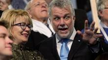 The new Quebec Liberal Party Leader Philippe Couillard, right, reacts to the crowd as his wife Suzanne Pilote, left, looks on Sunday, March 17, 2013, at the leadership convention in Montreal. (Jacques Boissinot/THE CANADIAN PRESS)