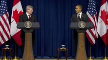 President Barack Obama and Canadian Prime Minister Stephen Harper speak in the South Court Auditorium on the White House complex in Washington, Wednesday, Dec. 7, 2011. (Carolyn Kaster/AP)